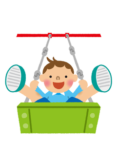 Boy playing on a swing