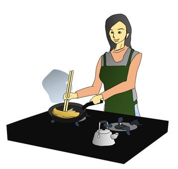 계란말이를 만드는 여성