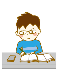 A boy focused on studying