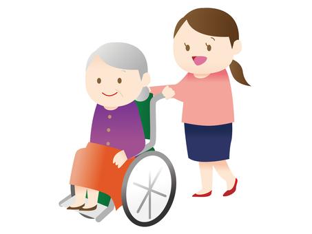 A woman pressing a wheelchair