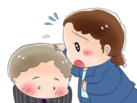 Woman pointing to male head