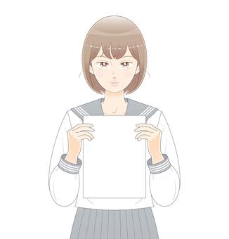 紙を持つ女子