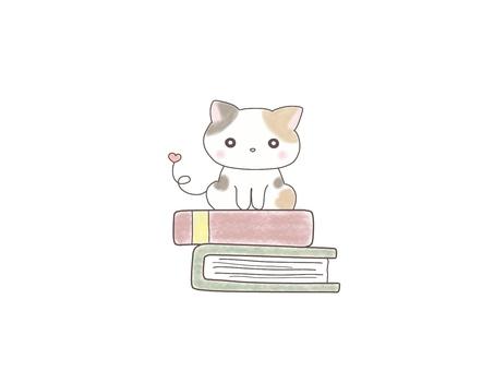 Kitten sitting on a book