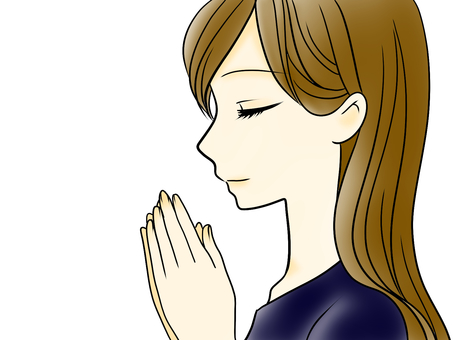 Woman praying with hands together