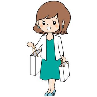 종이 가방을 들고있는 여성
