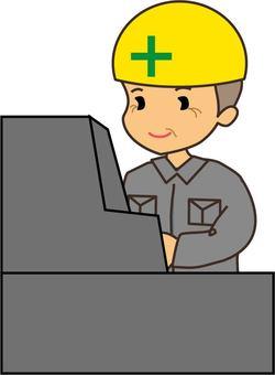 Senior male worker operating a machine