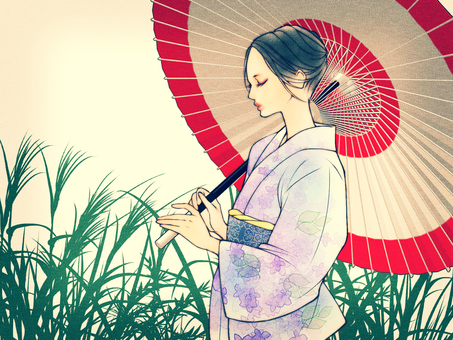 草背景の着物美人