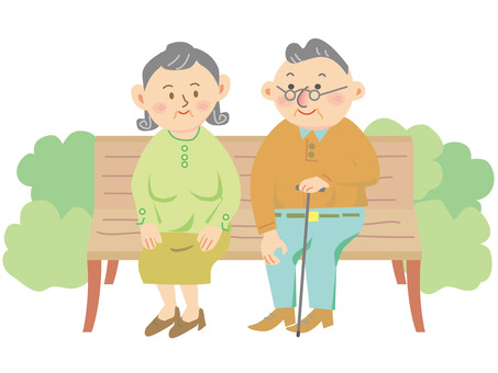 The elderly people sitting on the bench