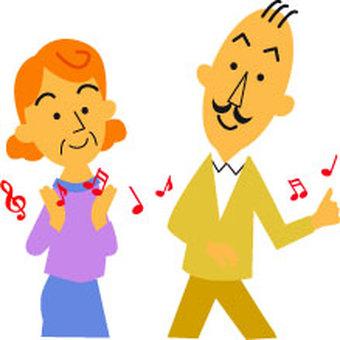 Two elderly people enjoying music