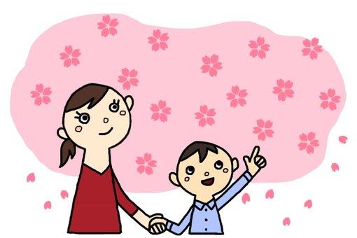 一個男孩和一個母親正在觀賞櫻花
