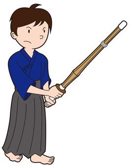 A kendo boys holding a bamboo sword 1