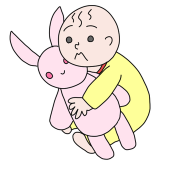 A baby holding a rabbit doll