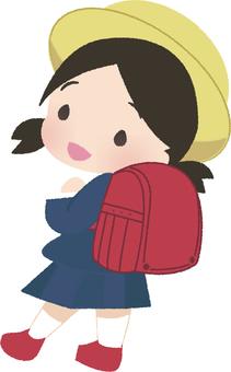Girl showing a school bag