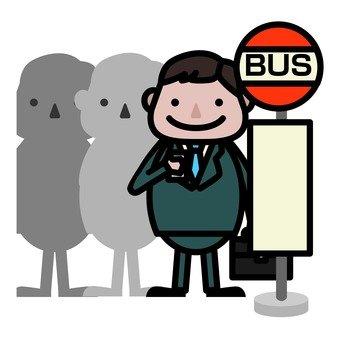 A man waiting at a bus tate