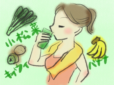 A woman drinking a green smoothie