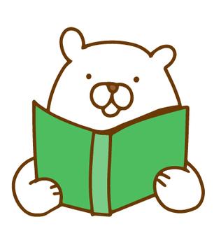 A white bear reading a book