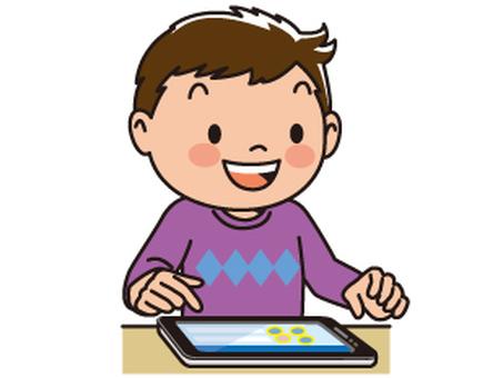 태블릿을 사용하는 소년
