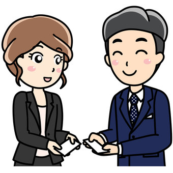 Male female office worker - exchanging business cards with a smile