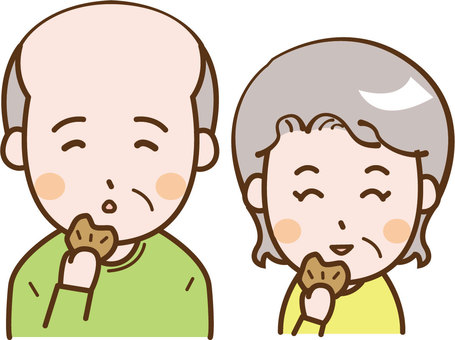Elderly couple eating crackers