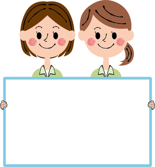 Two women with message board
