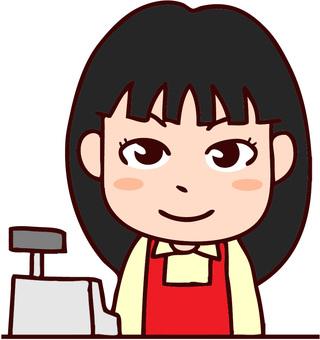 Female clerk standing on cash register