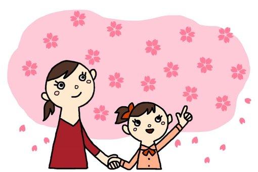 一位女孩和一位正在觀賞櫻花的母親