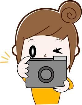 Camera, woman (bun head), upper body