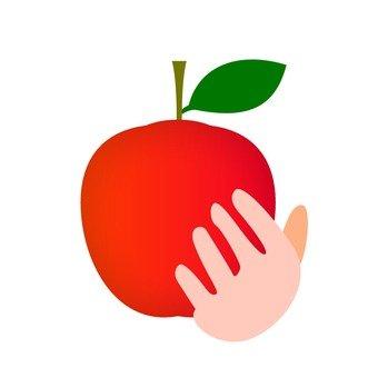 手拿著蘋果