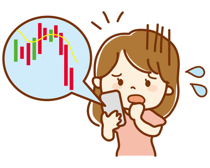 スマホでチャートを見る女性投資家