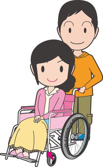 A woman sitting in a wheelchair and an accompanying man