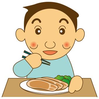 一個男人吃肉