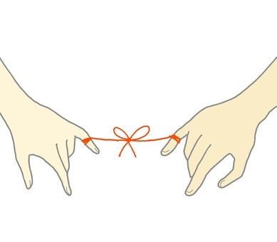 赤い糸で結ばれた手