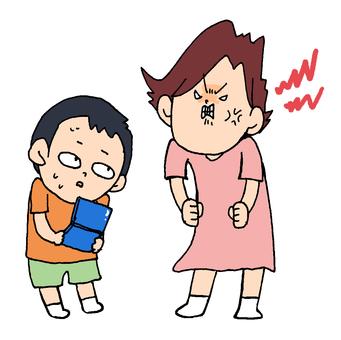 母親に怒られる少年