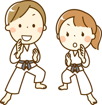 Boys and girls learning karate