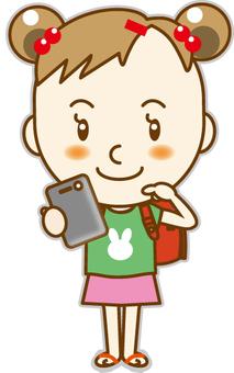 Elementary school students using smartphones