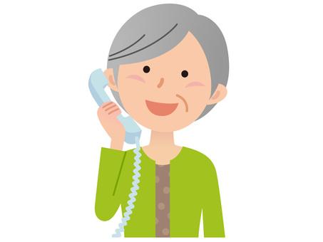 51030. Senior woman, phone
