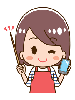 Housewife holding a smartphone holding a pointer