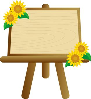 Sunflower and wooden easel board
