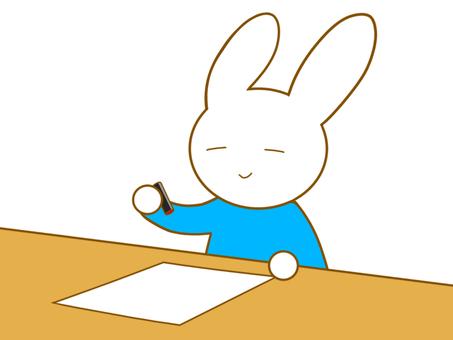印鑑を押すウサギ