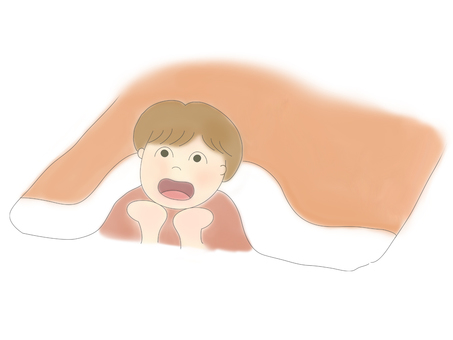 A boy who is lying down and watching a movie