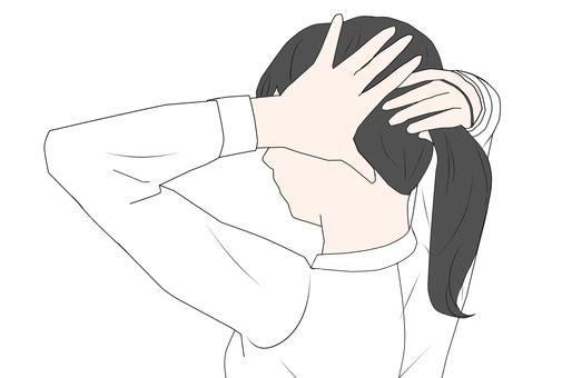 Woman tying hair (black hair) (work)