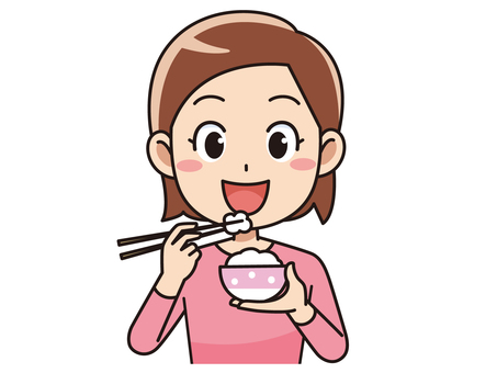 A woman eating rice
