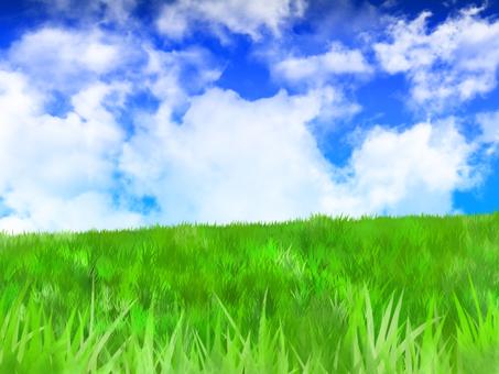 草原と大きな雲