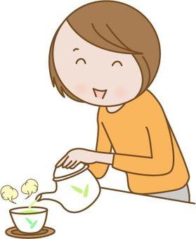 A woman putting tea