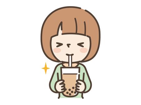 Girl drinking tapioca milk tea
