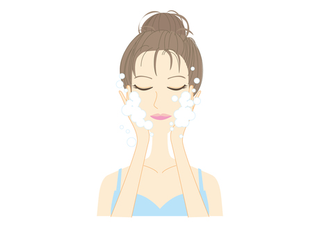 A woman washing her face