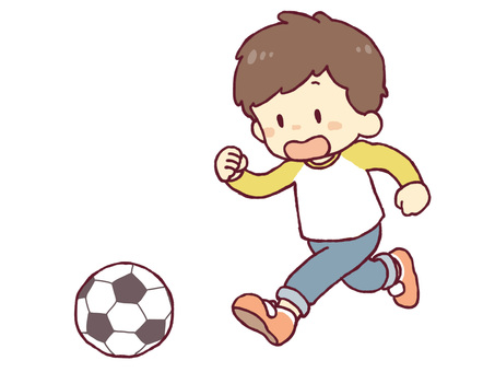 A boy playing with a ball