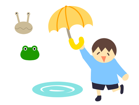 雨に喜ぶ男の子
