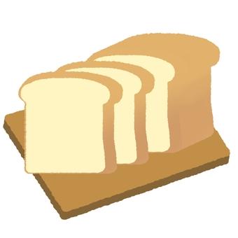 도마에 놓인 식빵 한 덩어리