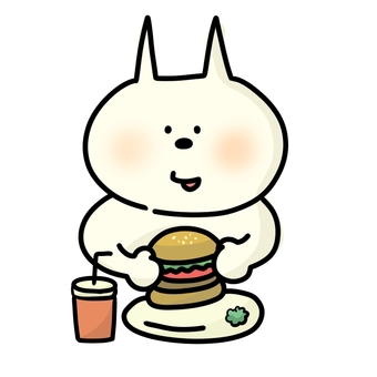 Cat eating hamburger